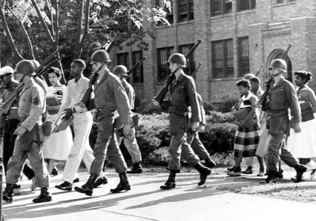 Eisenhower sends in Federal Troops