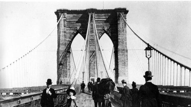 The Brooklyn Bridge opens.