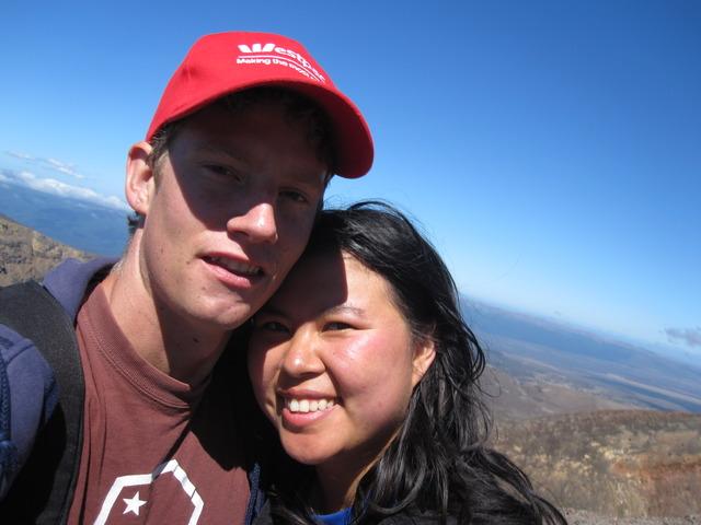 Photo of Sam and Susie walking the Tongariro Crossing