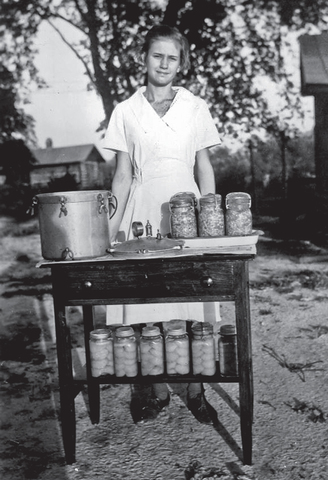 The first girls' tomato club (4-H) organized by Marie Cromer a teacher, through Agricultural Extension. She organized them after learning of boys' corn clubs.