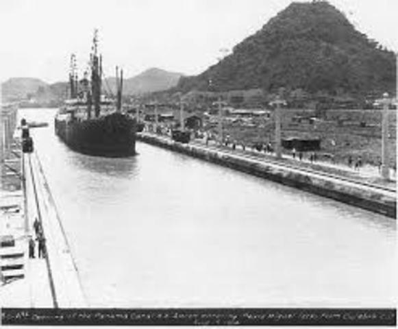 The Panama Canal is completed and opened for traffic