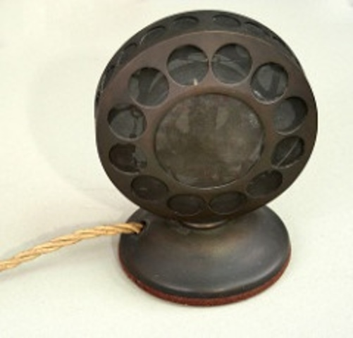 Thomas Edison invents the carbon button microphone