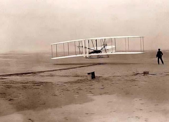 The Wright brothers fly the first airplane