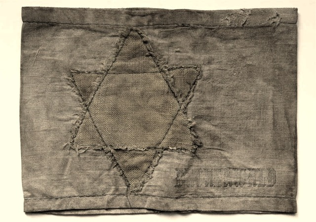 Jews in Poland must wear an armband or yellow star patch
