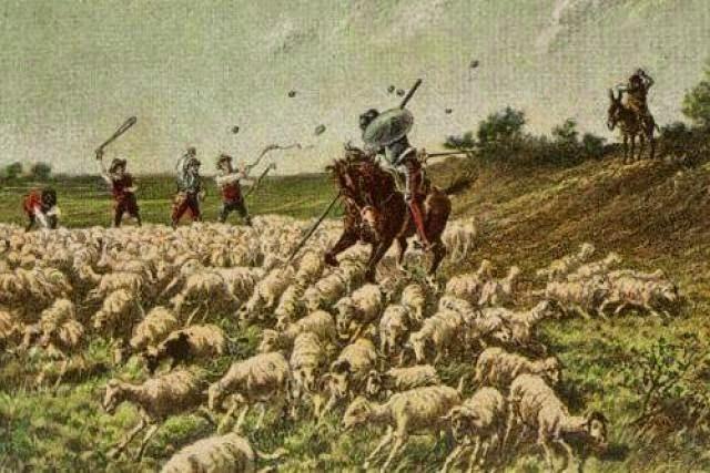 Don Quijote ve un rebaño de ovejas y al pensar que era un ejercito se rompe los dientes al intentar luchar contra los cabreros.