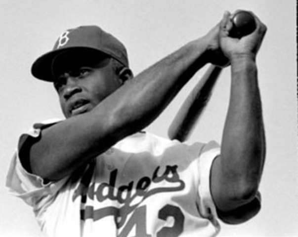 Jackie Robinson becomes the first African-American to play Major League Baseball when he is signed to the Brooklyn Dodgers by Branch Rickey.