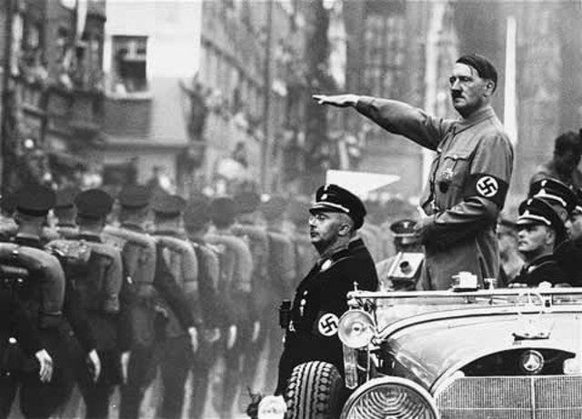 Hitler  begins military buildup