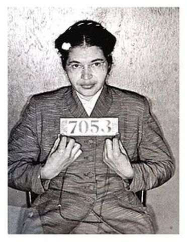 Rosa Parks refuses to give her bus seat