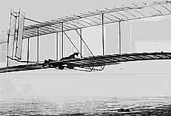 Wilbur Wright begins glider experiments