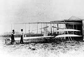 Orville pilots the first flight of the Wright Flyer I