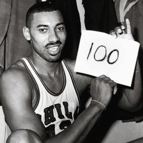 Wilt Chamberlin scores a NBA record 100 points in a game