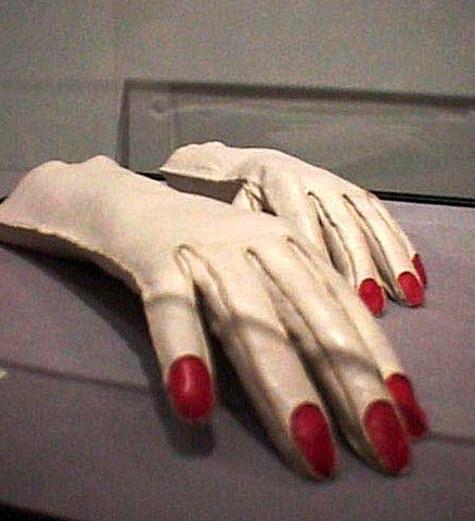 gloves with red python nails,