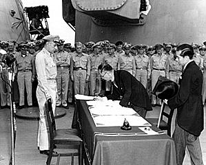 Japan signs the surrender documents, marking the end of the war.