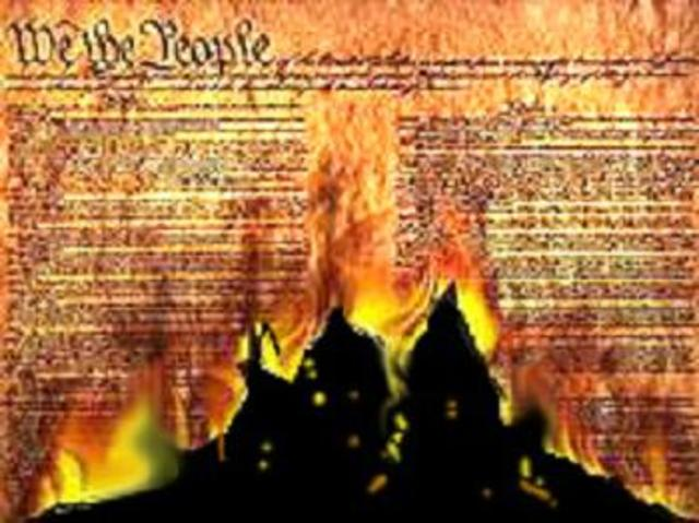 Garrison publicly burns a copy of the U.S. Constitution
