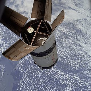 Apollo 7 orbits the Earth and Moon