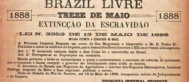 Princesa Isabel assina a Lei Áurea, que extingue a escravidão no Brasil