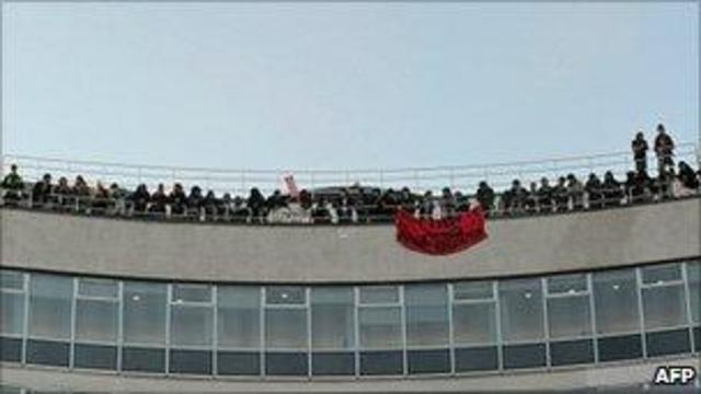 Student protester arrested after fire extinguisher is thrown from roof