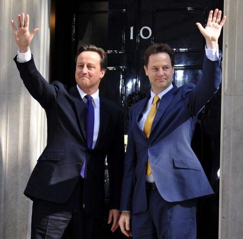 David Cameron and Nick Clegg pledge 'united' coalition government.
