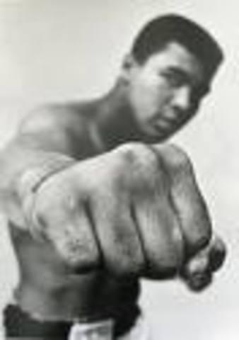 Wins gold medal, Rome Olympics, light-heavyweight boxing