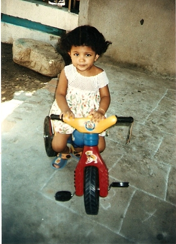 My godmother gave me my first tricycle