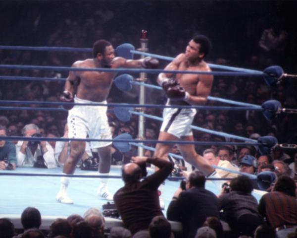 Muhammad Ali defeats Joe Frazier in a rematch fight