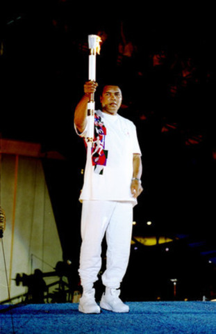 Muhammad Ali lights the flame at the 1996 Summer Olympics opening ceremony