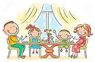 Mi familia nos sentamos juntos y desayunamos en la mesa floreada