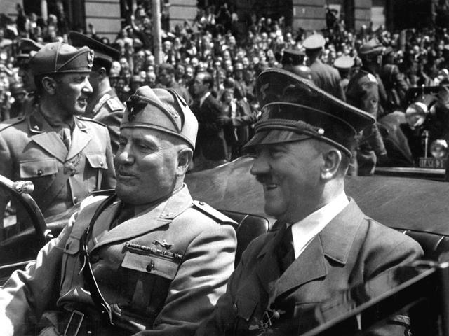 Hitler and Mussoloni form Rome-Berlin Axis.