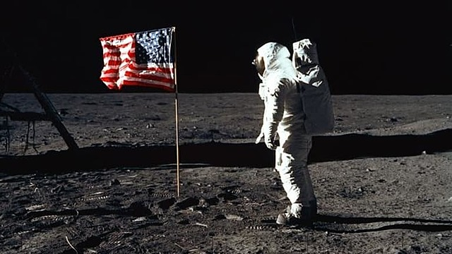Americans land on the moon