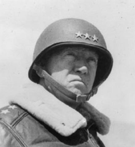 General George S. Patton relieves Bastogne, blunts German offensive at Bastogne