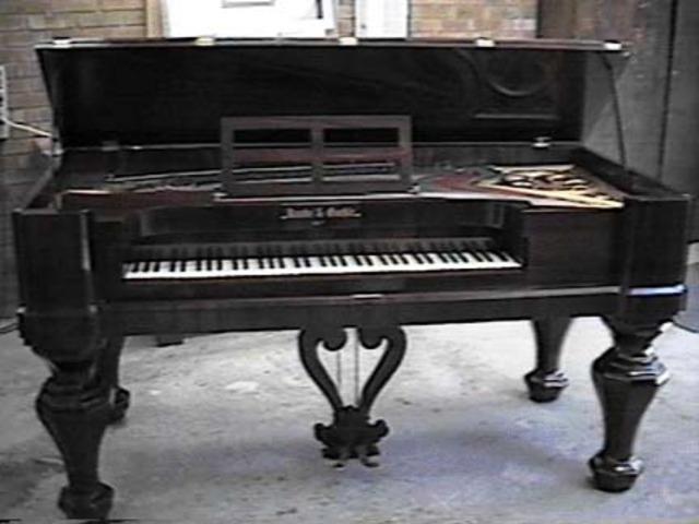 square grand piano.