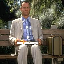 Forrest sits and talks to people on the park bench