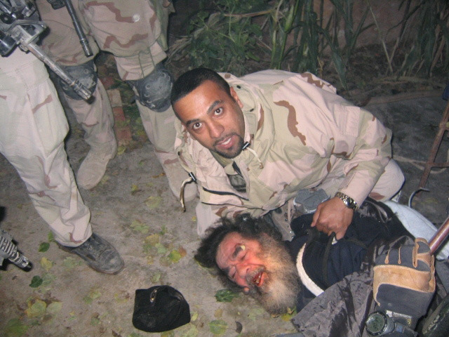 Saddam Hussein is captured by US forces at a farmhouse in ad-Dawr