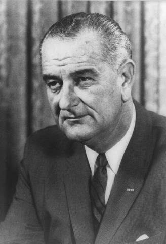 Lyndon B. Johnson takes office