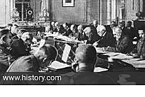 The Treaty of Versailles is signed, ending World War I.