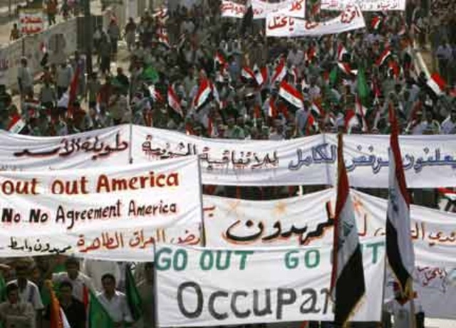 Tens of thousands of Iraqis protest to demand the immediate departure of coalition forces.