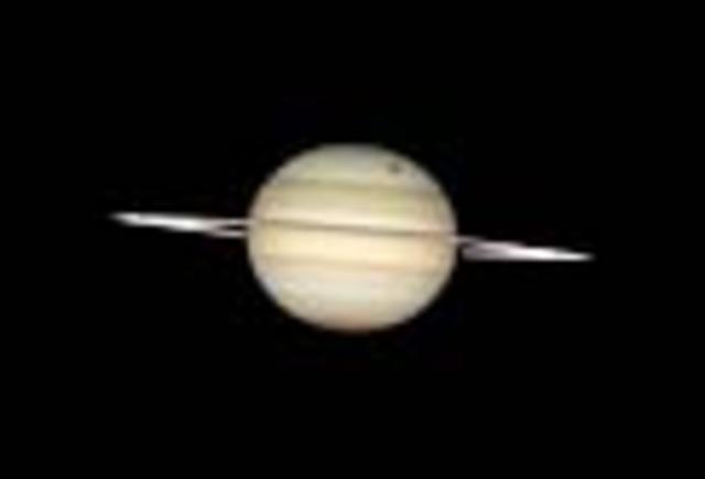 Pioneer 10 from NASA visits Saturn (Hubble Telescope Photo)