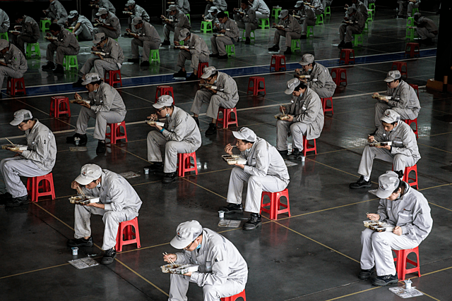 Chinese companies back to work with stricter rules
