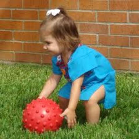 throws ball overhand&kicks it forward (21 mnths)