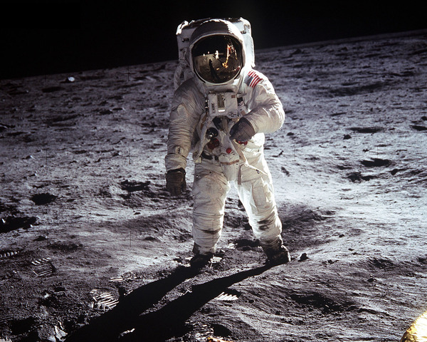 """Appolo 11 crew member Neil Armstrong is the first man to walk on the moon. His fellow crew member Edwin """"Buzz"""" Aldrin is right behind him making him the second man to walk on the moon."""