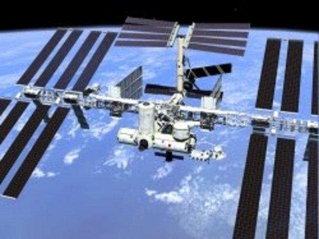 Human habitation in the International Space Station begins.