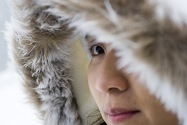 Inuit Girl looks out into the Arctic