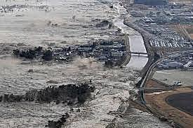 A series of massive earthquakes hit north-east Japan, unleashing a 10-metre tsunami