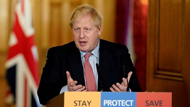 U.K. urges public to use face masks