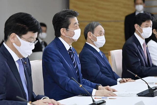 Japan to give two masks each to 50 million households to fight virus