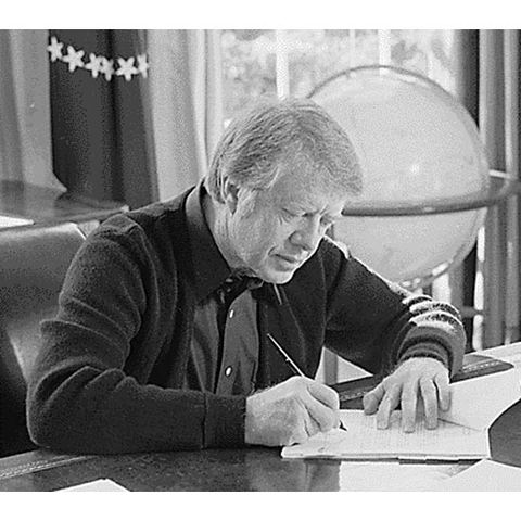 President Jimmy Carter signs the Full Employment and Balanced Growth Act (Humphrey-Hawkins Act)