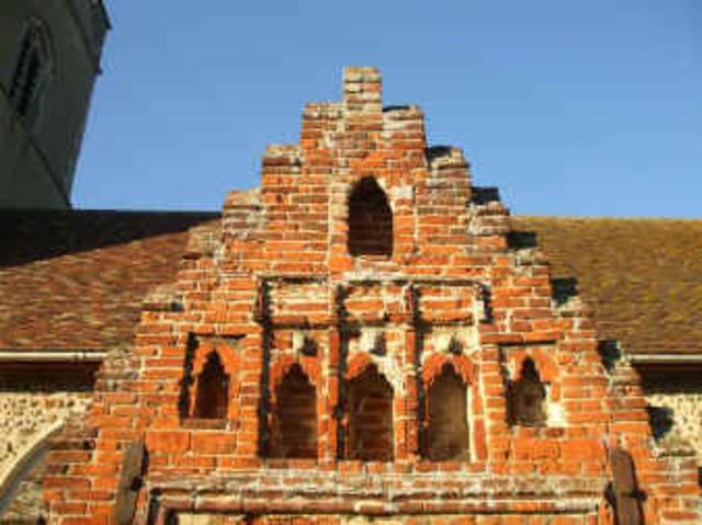 The brick church porch is Tudor (16th Century)