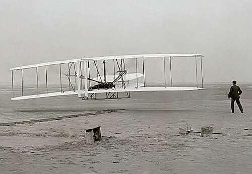First engine powered flight