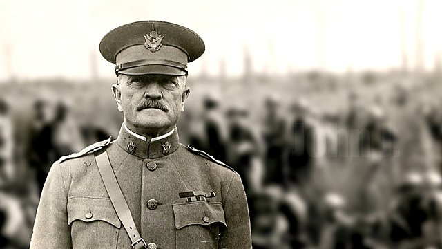 General John J. Pershing, newly selected commander of the American Expeditionary Forces, arrives in England with his staff.