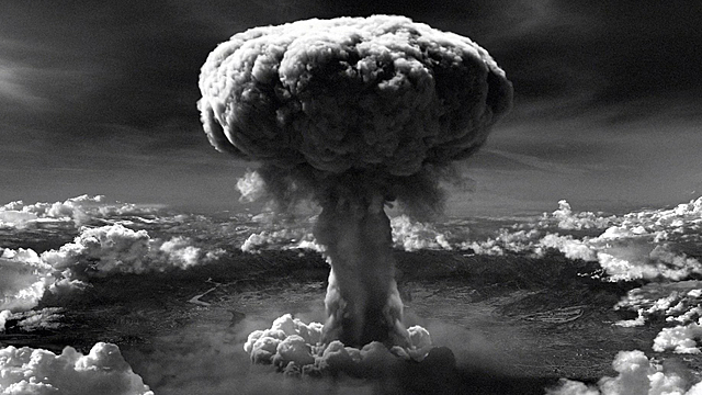Developed to drop on the Germans, the first atomic bomb tumbles through the bomb-bay doors of the Enola Gay.